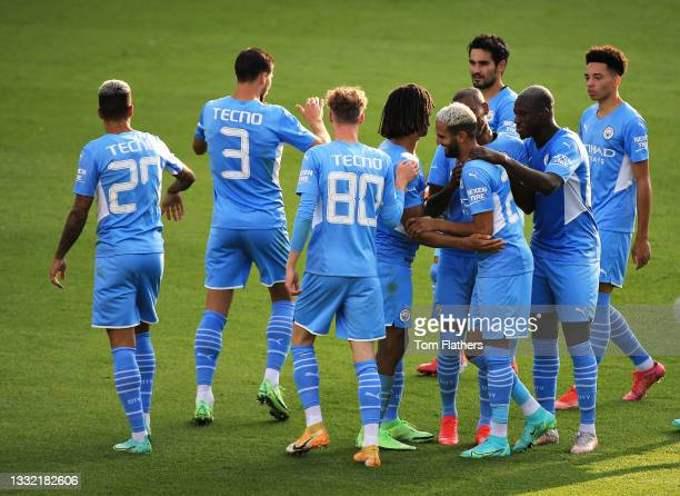 The Manchester City team celebrate scoring their second goal during the pre-season friendly match between Manchester City and Blackpool at Manchester...
