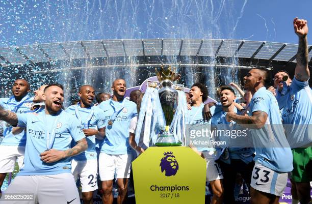The Manchester City team celebrate with The Premier League Trophy after the Premier League match between Manchester City and Huddersfield Town at...