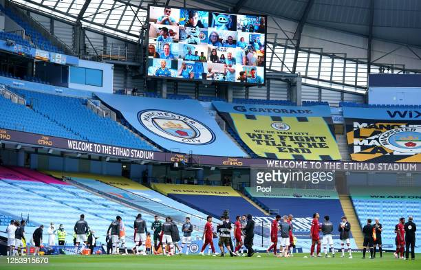 The Manchester City team create a guard of honor for the Liverpool FC team prior to the Premier League match between Manchester City and Liverpool FC...