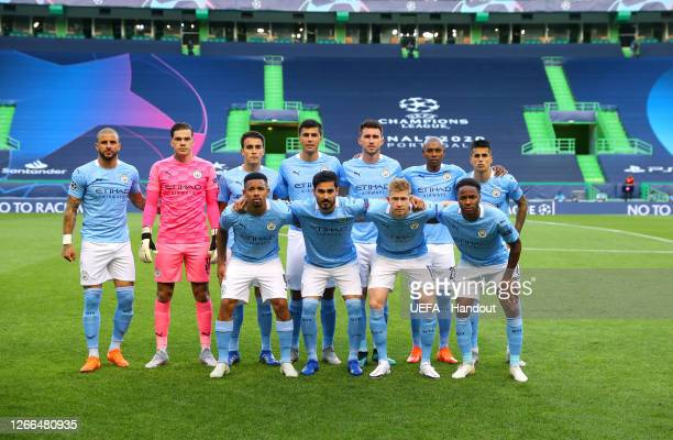 The Manchester City team line up prior to the UEFA Champions League Quarter Final match between Manchester City and Lyon at Estadio Jose Alvalade on...