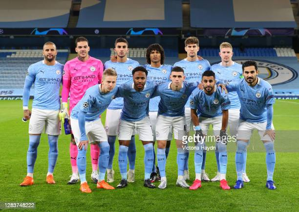 The Manchester City team line up prior to the UEFA Champions League Group C stage match between Manchester City and Olympiacos FC at Etihad Stadium...