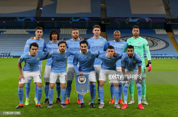The Manchester City team pose for a team photo prior to the UEFA Champions League Group C stage match between Manchester City and Olympique de...