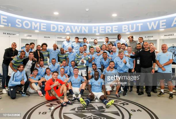 The Manchester City team pose with Mateo Silva following the Premier League match between Manchester City and Huddersfield Town at Etihad Stadium on...