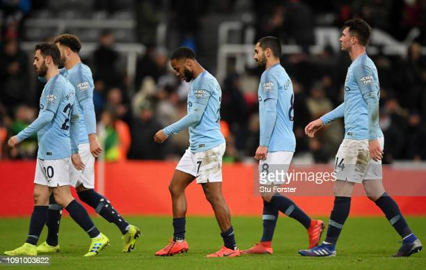 The Manchester City team walk off dejcted after the Premier League match between Newcastle United and Manchester City at St James Park on January 29...