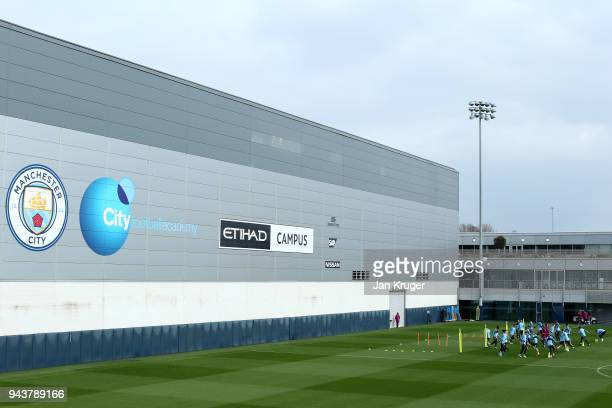 The Manchester City team warms up during a training session at Manchester City Football Academy on April 9 2018 in Manchester England