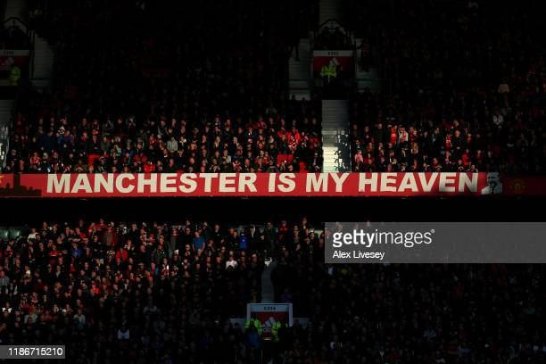 The Manchester is my Heaven banner is seen as fans look on from the stands during the Premier League match between Manchester United and Brighton...