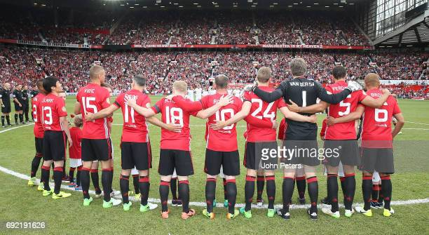 The Manchester United '08 XI take part in a minute's silence in memory of the victims of the terror attacks in Manchester and London ahead of the...