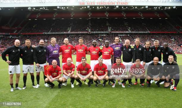 The Manchester United '99 Legends players line up for a team photo prior to the 20 Years Treble Reunion match between Manchester United '99 Legends...