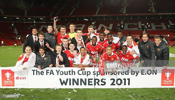 The Manchester United Academy Under18s squad celebrate with the FA Youth Cup trophy after the FA Youth Cup Final Second Leg match between Manchester...