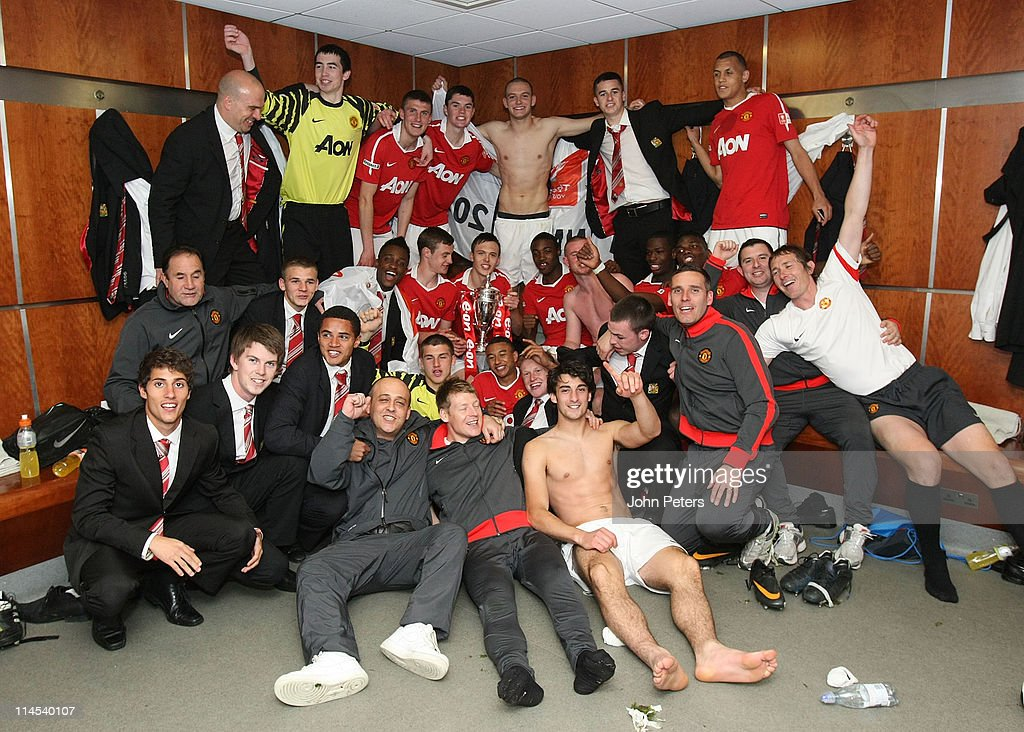 The Manchester United Academy Under-18s squad celebrate with the FA Youth Cup trophy in the dressing room after the FA Youth Cup Final Second Leg match between Manchester United Academy Under-18s and Sheffield United Academy Under-18s at Old Trafford on May 23, 2011 in Manchester, England.