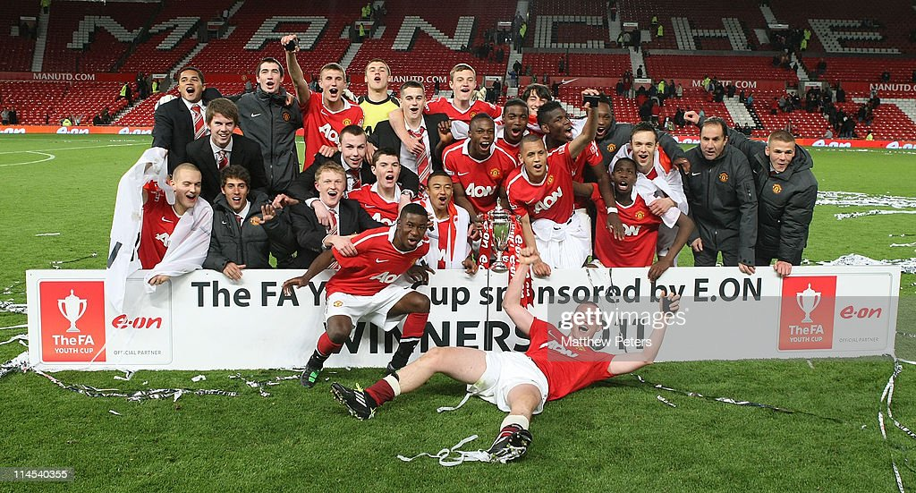 The Manchester United Academy Under-18s squad celebrate with the FA Youth Cup trophy after the FA Youth Cup Final Second Leg match between Manchester United Academy Under-18s and Sheffield United Academy Under-18s at Old Trafford on May 23, 2011 in Manchester, England.