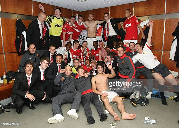 The Manchester United Academy Under18s squad celebrate with the FA Youth Cup trophy in the dressing room after the FA Youth Cup Final Second Leg...