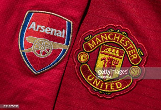 The Manchester United and Arsenal club crests on home shirts on April 24, 2020 in Manchester, England