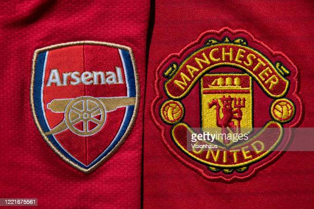 The Manchester United and Arsenal club crests on home shirts on April 24 2020 in Manchester England