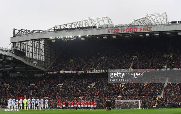 The Manchester United and Huddersfield starting XIs pause for a minute silence in comemmoration of the 1958 Munich Air Disaster in the 60th...