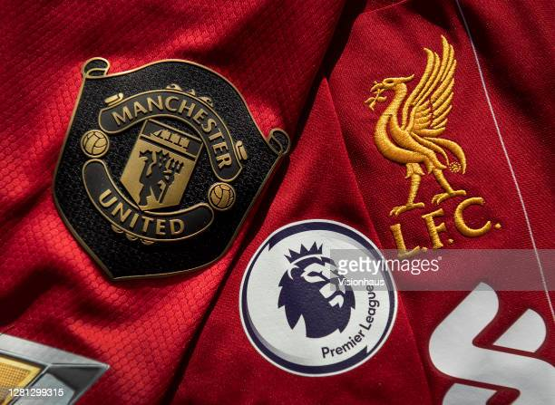 The Manchester United and Liverpool club badges with the Premier League logo on October 20, 2020 in Manchester, United Kingdom.