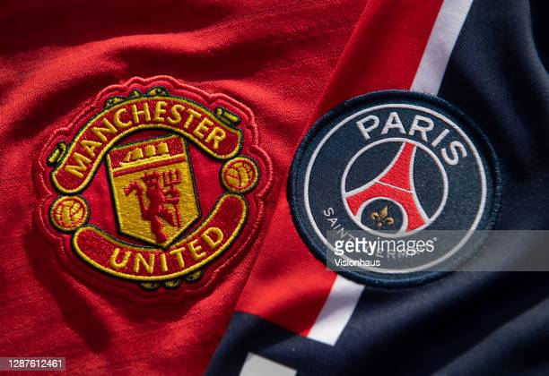 The Manchester United and Paris SaintGermain club badges on their home shirts on November 25 2020 in Manchester United Kingdom
