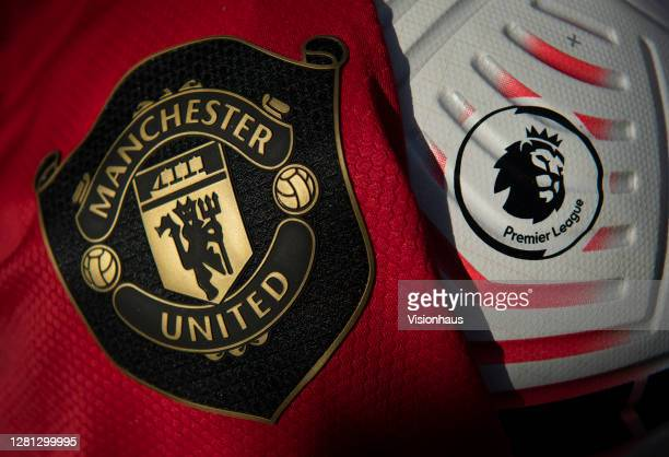 The Manchester United club badge on a home shirt with the official Premier League match ball on October 20, 2020 in Manchester, United Kingdom.