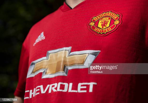 The Manchester United club crest and the logos for sponsors Chevrolet and adidas on the first team home shirt on May 4 2020 in Manchester England