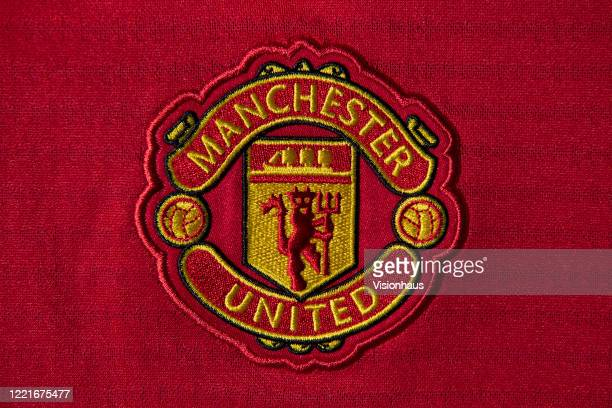 The Manchester United club crest on a first team home shirt on April 24 2020 in Manchester England