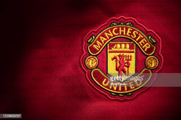 The Manchester United club crest on the first team home shirt displayed on May 6 2020 in Manchester England