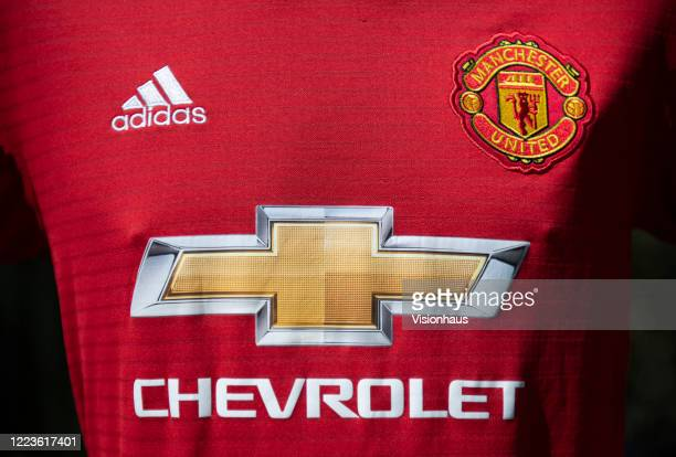 The Manchester United club crest on the first team home shirt displayed with sponsors adidas and Chevrolet on May 5 2020 in Manchester England