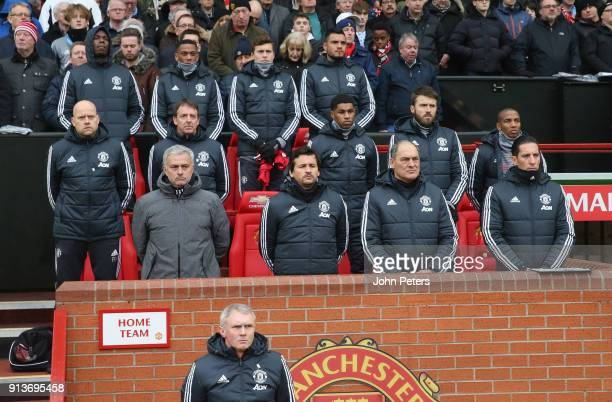 The Manchester United coaching team and substitutes take part in a minute's silence commemorating the 60th Anniversary of the Munich Air Disaster...