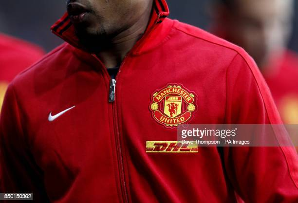 The Manchester United emblem and the DHL logo on the training jacket of Manchester United's Patrice Evra