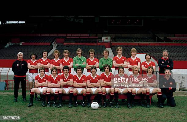 The Manchester United first team squad photographed at Old Trafford in Manchester circa February 1978 Back row Tommy Cavanagh Arthur Albiston Alex...