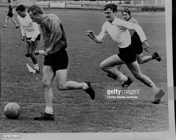 The Manchester United Football Club team trained at the Showground today for their match against a Sydney team tomorrow nightTeam captain Denis Law...