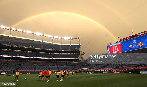 The Manchester United in action during an open training session under a rainbow as part of their preseason tour of the United States at Sports...