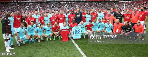 The Manchester United Legends and Barcelona Legends teams lines up ahead of the MU Foundation charity match between Manchester United Legends and...