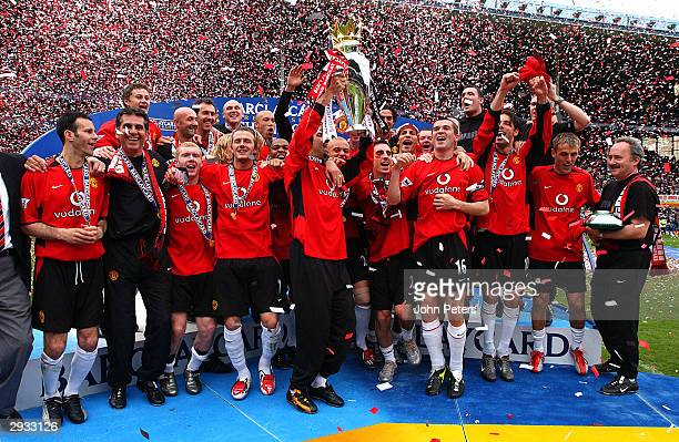 The Manchester United players celebrate winning the Premiership Trophy after the FA Barclaycard Premiership match between Everton v Manchester United...