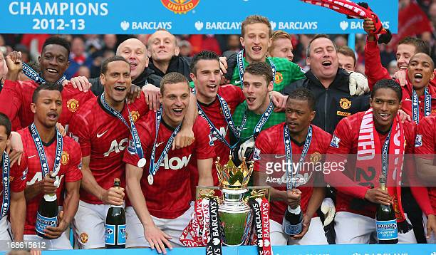 The Manchester United players celebrate with the Premier League trophy following the Barclays Premier League match between Manchester United and...