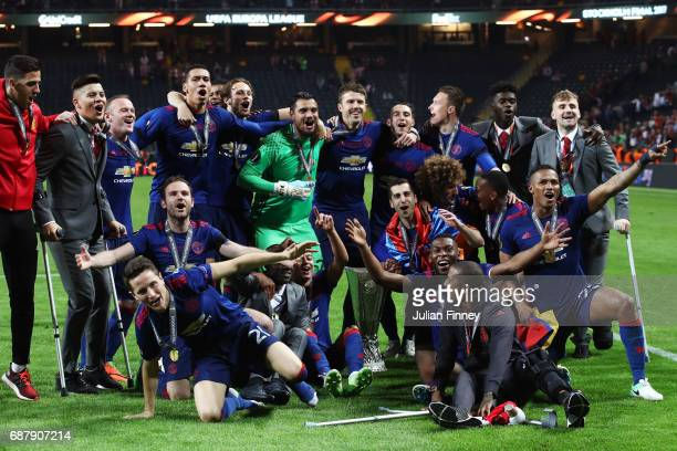 The Manchester United players celebrates with The Europa League trophy after the UEFA Europa League Final between Ajax and Manchester United at...