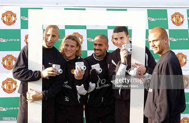 The Manchester United players from left to right Rio Ferdinand Diego Forlan Juan Sebastian Veron John O'Shea and Wes Brown at the Fujifilm Cheki...
