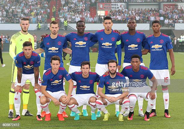 The Manchester United players line up for a team photo prior to the UEFA Europa League Group A match between Feyenoord and Manchester United at...