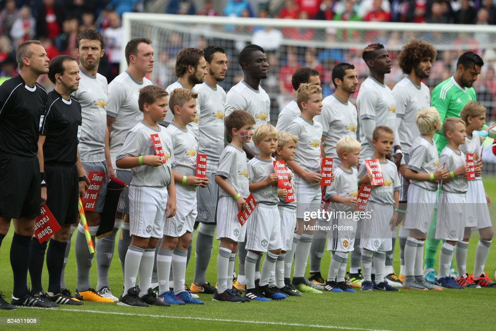 The Manchester United players line up with mascots prior to the pre-season friendly match between Valerenga and Manchester United at Ullevaal Stadion on July 30, 2017 in Oslo, Norway.