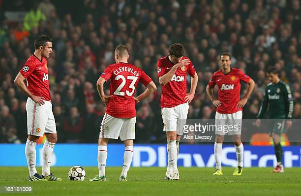 The Manchester United players look dejected after conceding a second goal during the UEFA Champions League Round of 16 Second leg match between...