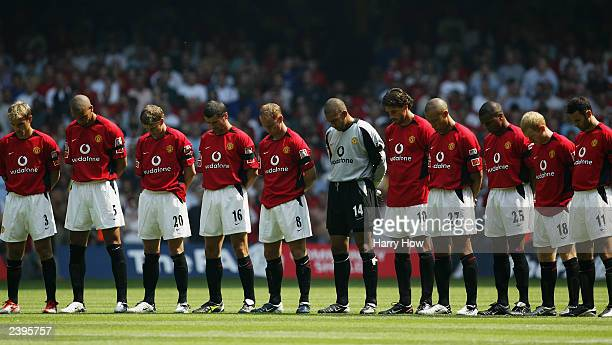 The Manchester United players stand for the minutes silence in respect for teammate Jimmy Davis who tragically died in a car crash the day before and...