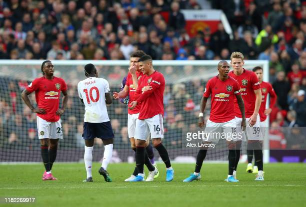 The Manchester United side approach Sadio Mané of Liverpool as his goal is disallowed during the Premier League match between Manchester United and...
