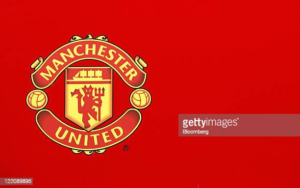 The Manchester United soccer club badge is displayed outside the Old Trafford stadium in Manchester UK on Thursday Aug 25 2011 Singapore beat Hong...