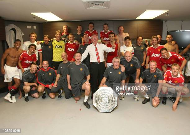 The Manchester United squad and coaching staff Goalkeeping coach Eric Steele Masseur Rod Thornley Michael Carrick John O'Shea Wayne Rooney Middle Row...