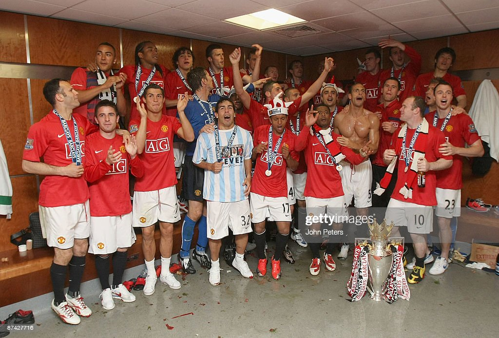 The Manchester United squad celeberate with the Premier League trophy in the dressing room after the Barclays Premier League match between Manchester United and Arsenal at Old Trafford on May 16 2009 in Manchester, England.