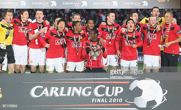 The Manchester United squad celebrate after the Carling Cup Final match between Aston Villa and Manchester United at Wembley Stadium on February 28...
