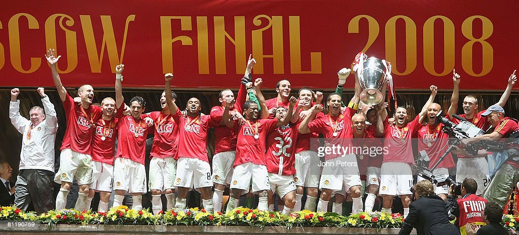 The Manchester United squad celebrate after winning the UEFA