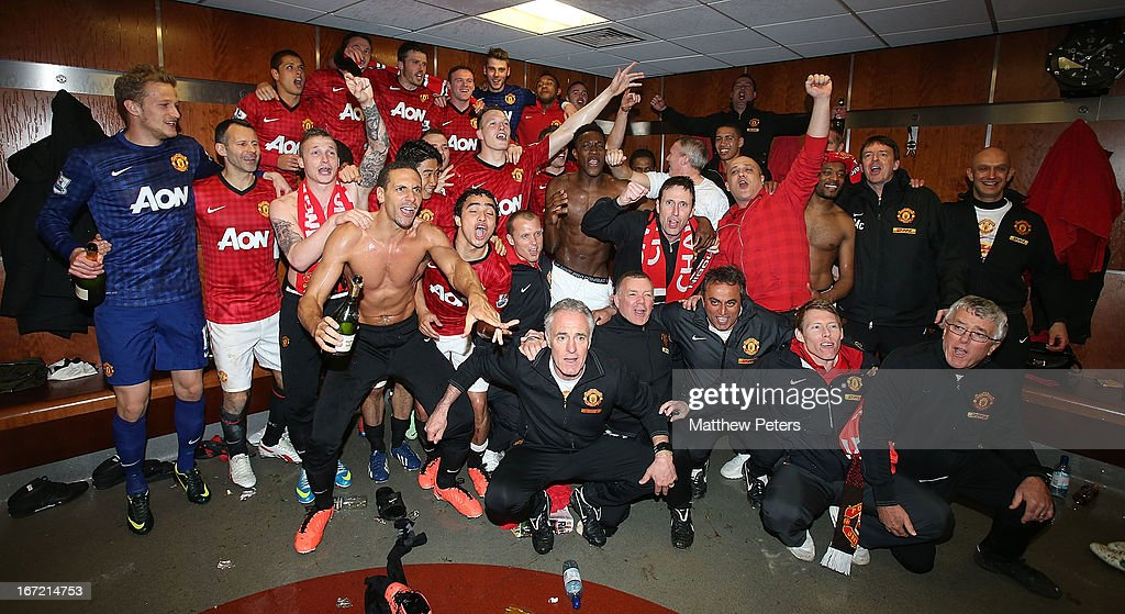The Manchester United squad celebrate in the dressing room after the Barclays Premier League match between Manchester United and Aston Villa at Old Trafford on April 22, 2013 in Manchester, England.