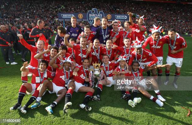 The Manchester United squad celebrate with the Barclays Premier League trophy after the Barclays Premier League match between Manchester United and...