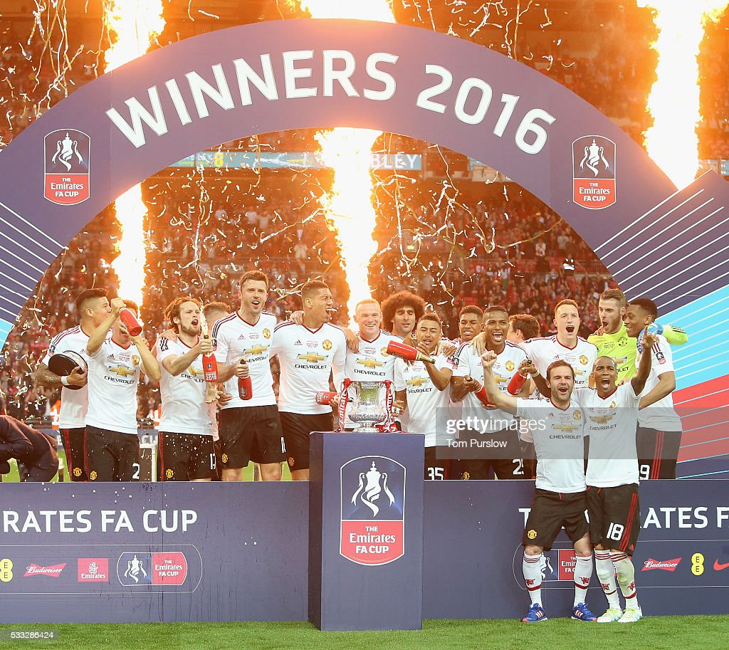 The Manchester United squad celebrate with the FA Cup trophy after The Emirates FA Cup final match between Manchester United and Crystal Palace at Wembley Stadium on May 21, 2016 in London, England.