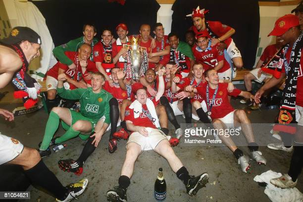 The Manchester United squad celebrate with the Premiership trophy after the Barclays FA Premier League match between Wigan Athletic and Manchester...